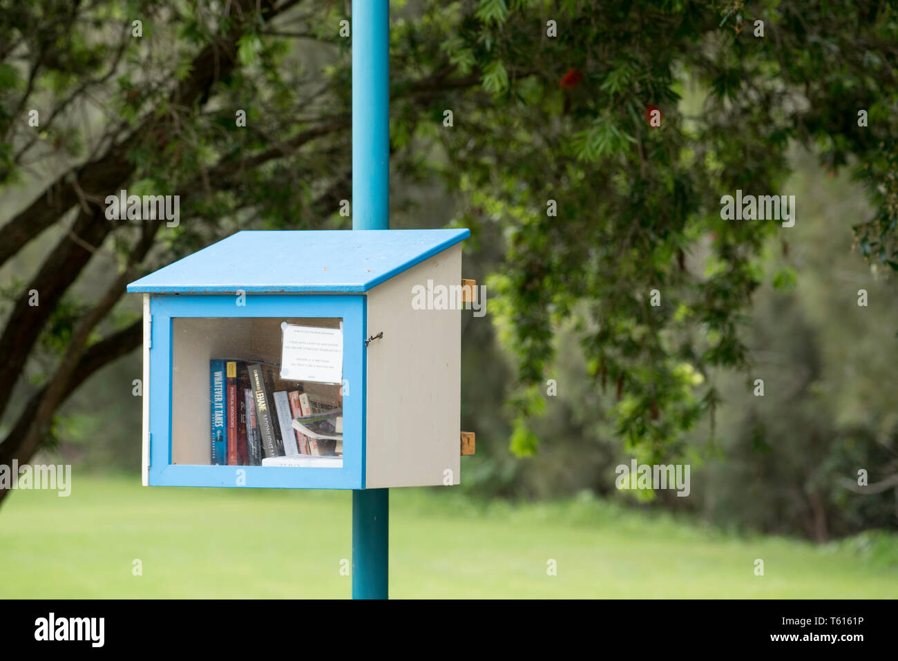 A street library or free book exchange near the local shops at the rural town of Kioloa / Bawley Point on the New South Wales south coast in Australia - Stock Image