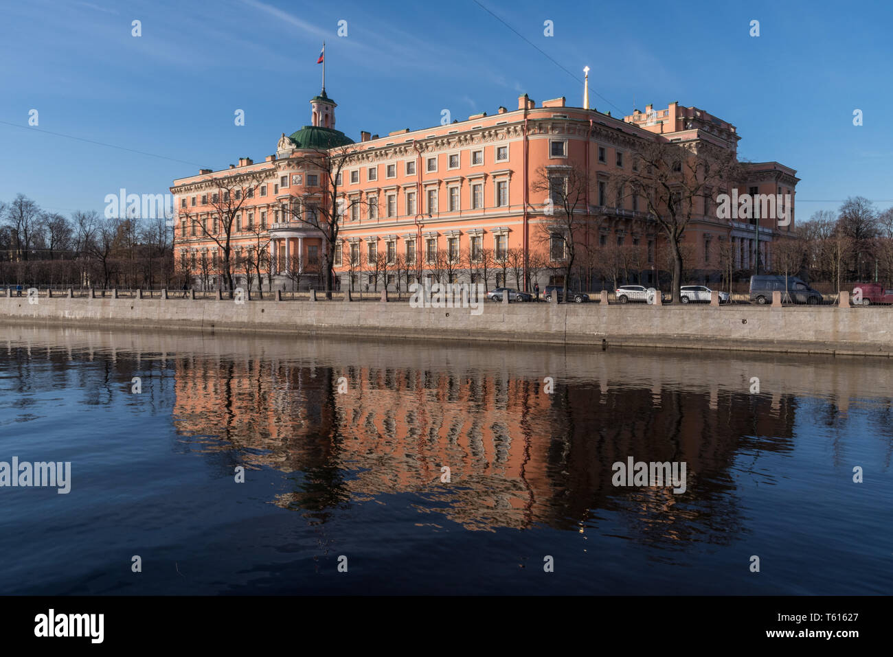 The facade of the Mikhailovsky (engineers') castle and the river Moika in Saint-Petersburg, Russia - Stock Image