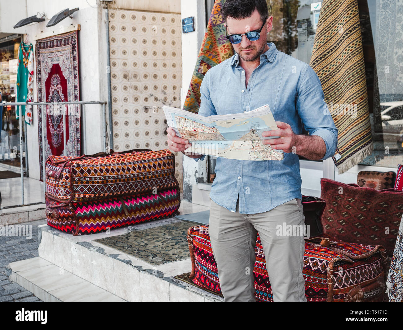 Handsome man with a tourist map exploring the sights of the