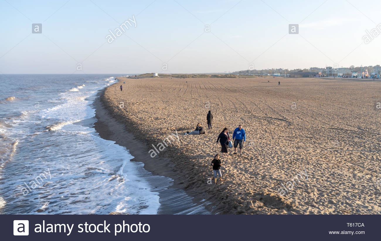 Holiday makers out on the beach in Skegness on Easter Weekend, despite cool temperatures, UK - Stock Image