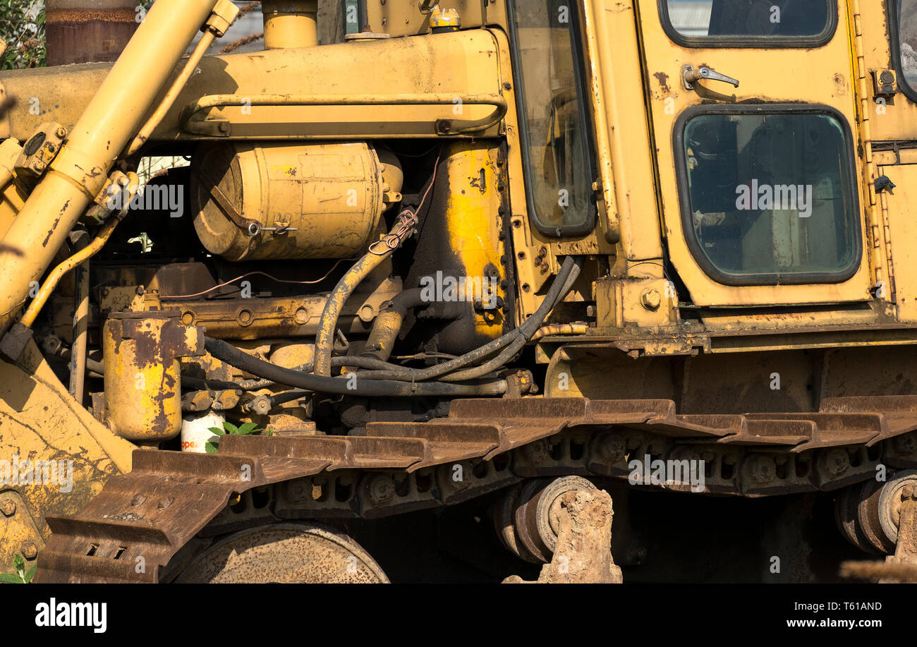 Old diesel engine bulldozer background - Stock Image