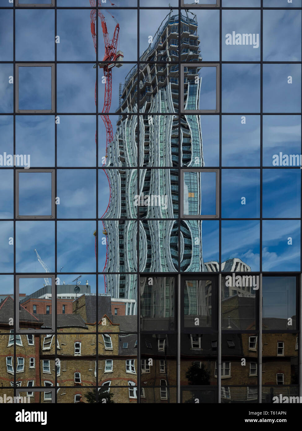 LONDON:  Reflection of Victorian Terraced Houses and Modern Tower under Construction - Stock Image