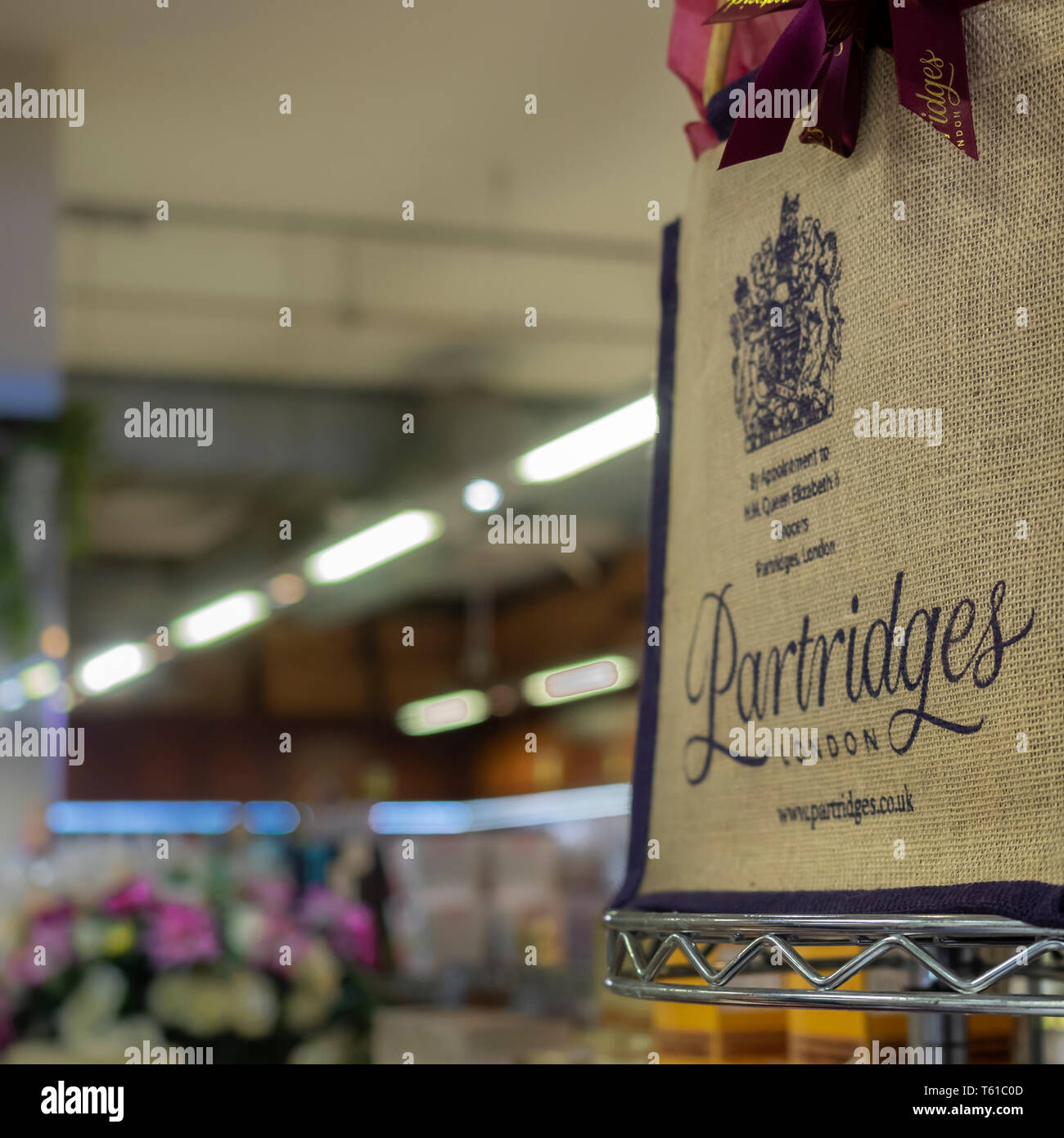 DUKE OF YORK SQUARE, LONDON: Advertising bag at Partridges Shop - Stock Image