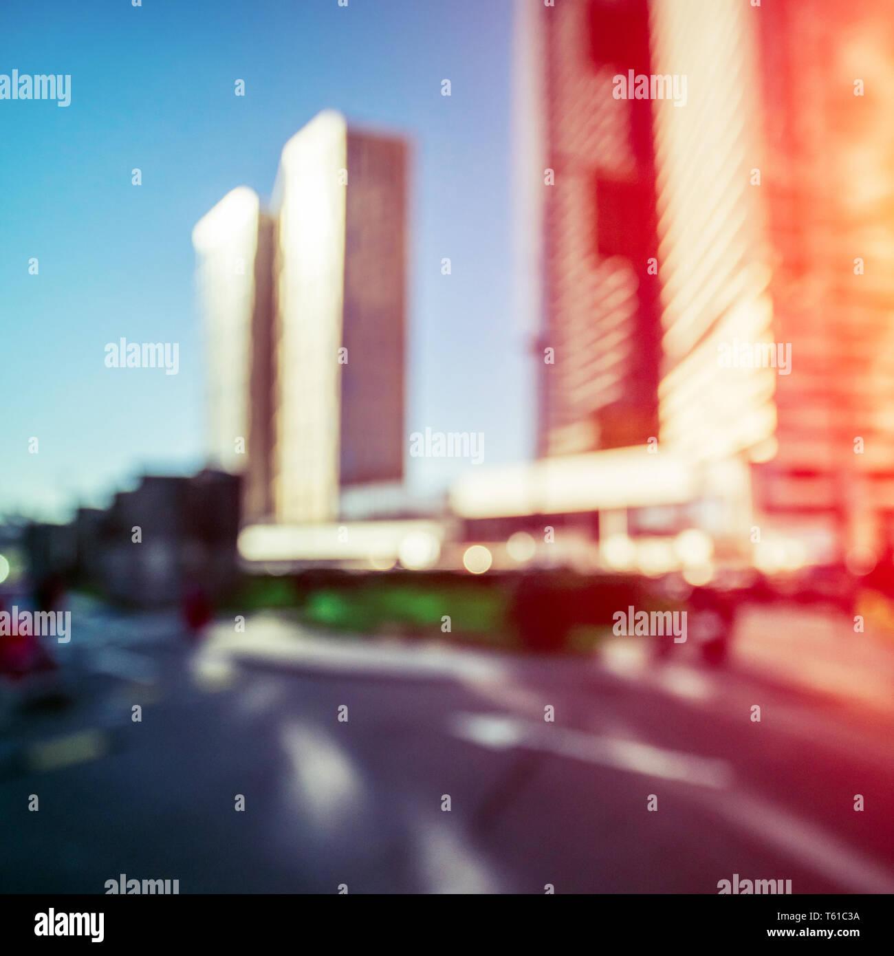 Modern city sunrise bokeh background - Stock Image
