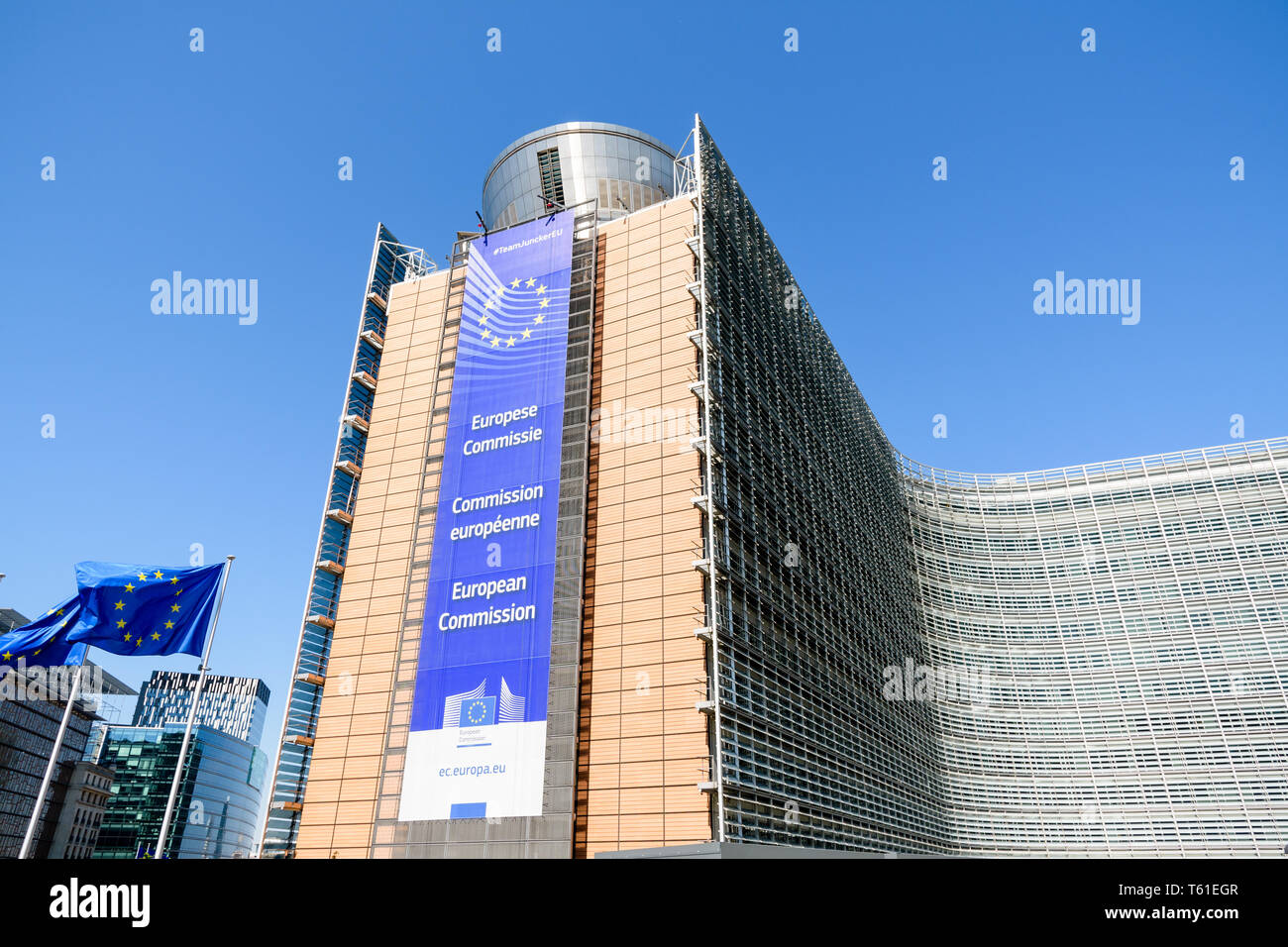 Low angle view of the large banner on the facade of the southern wing of the Berlaymont building, seat of the European Commission in Brussels, Belgium - Stock Image