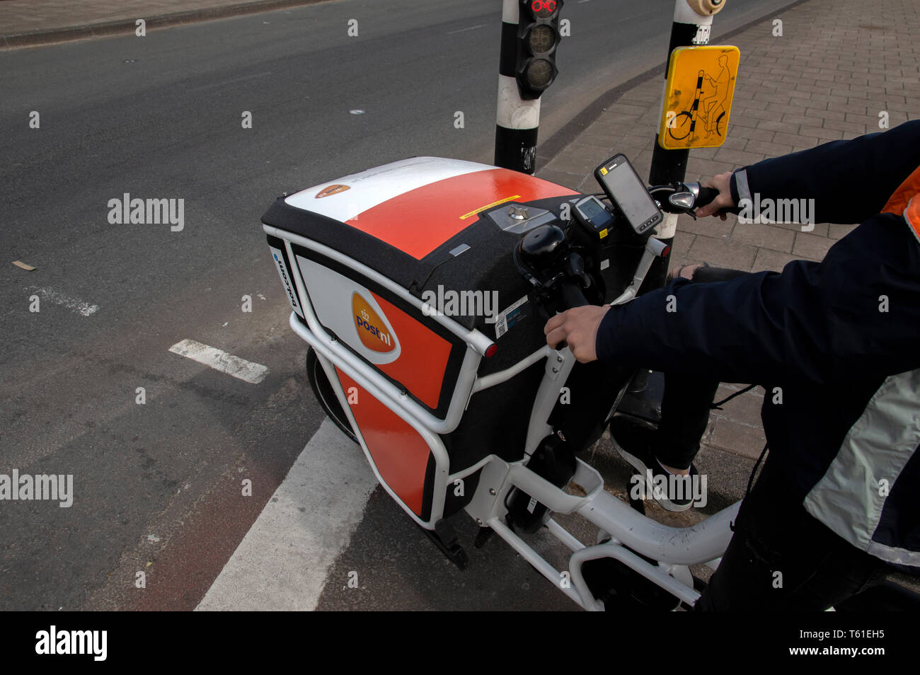 Electrical Bicycle From Post.nl At Amsterdam The Netherlands 2019 - Stock Image