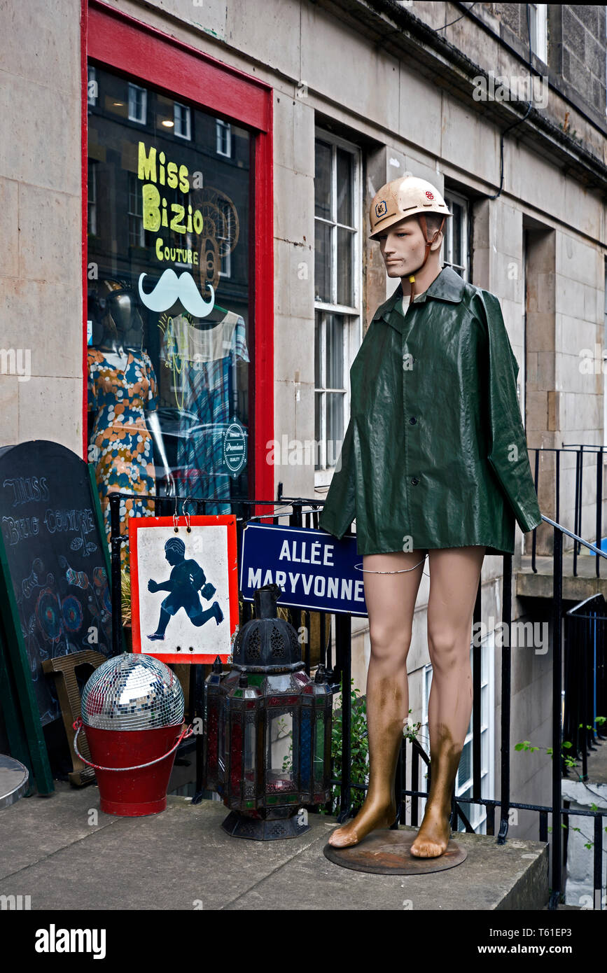An eclectic display of vintage fashion and objects outside a vintage clothes shop on St Stephen Street, Edinburgh, Scotland, UK. - Stock Image