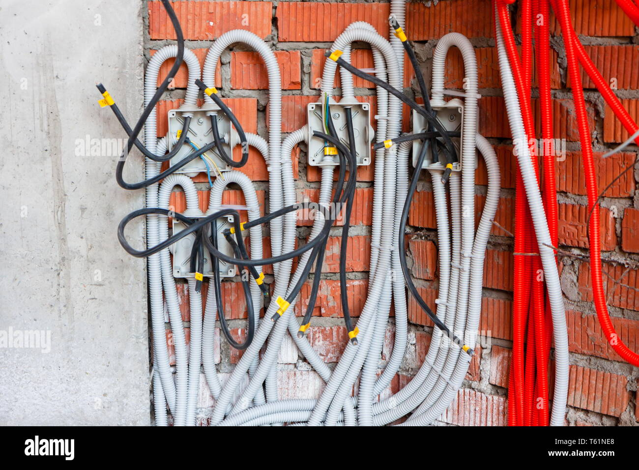 Soldered junction boxes with wires hidden in the corrugation. Realistic Stock Photo