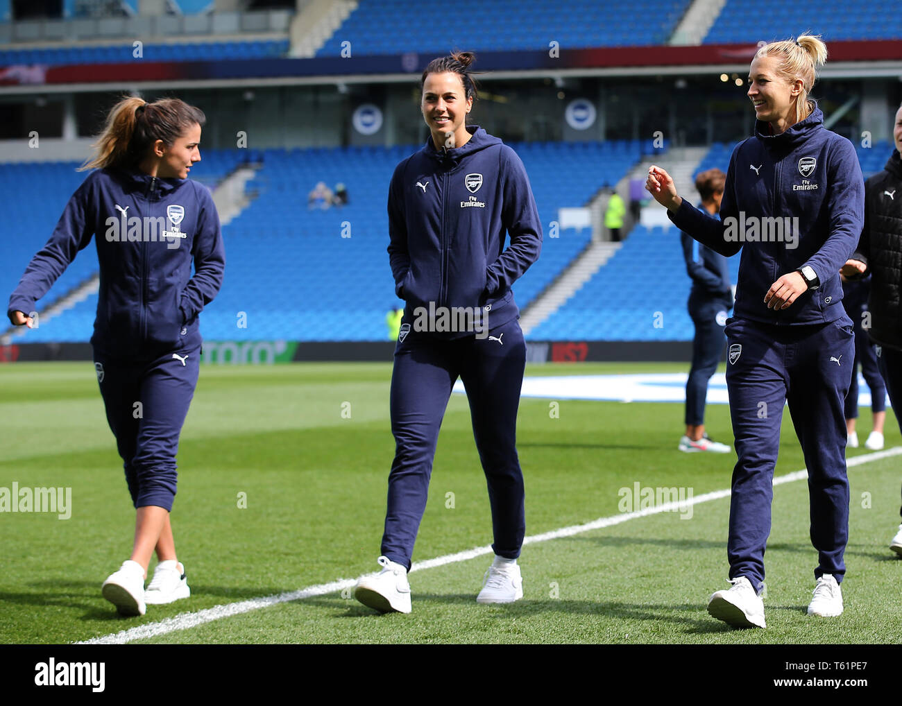Members of the Arsenal Women's team inspect the pitch before kick off during the FA Women's Super League match at the AMEX Stadium, Brighton. - Stock Image