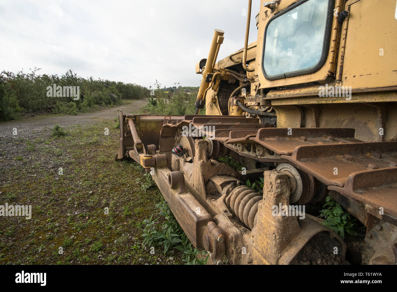 Rusty yellow bulldozer forward view - Stock Image