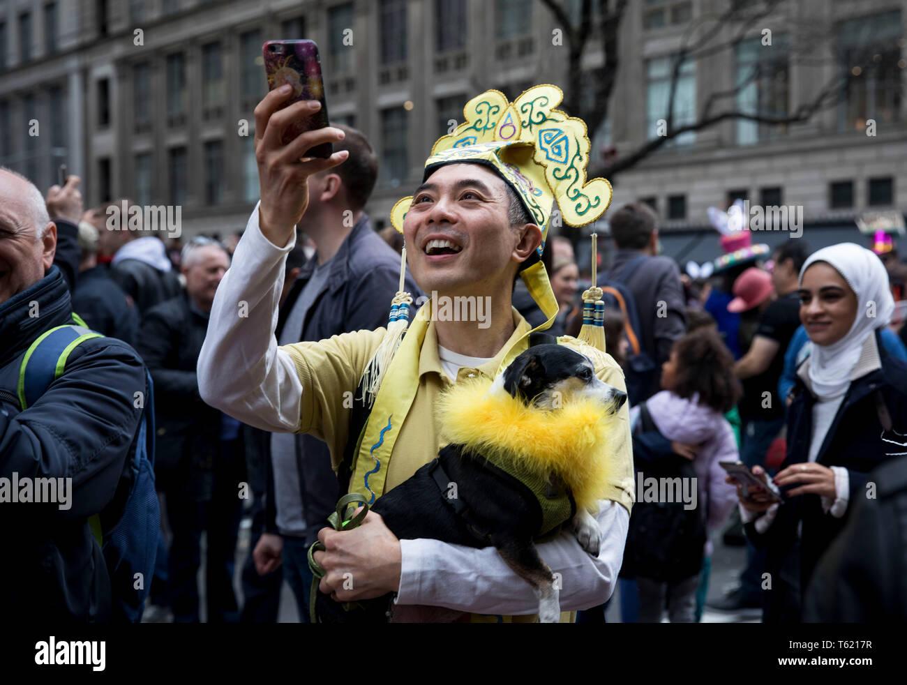 Beijing, USA  21st Apr, 2019  A costumed man holding a dog