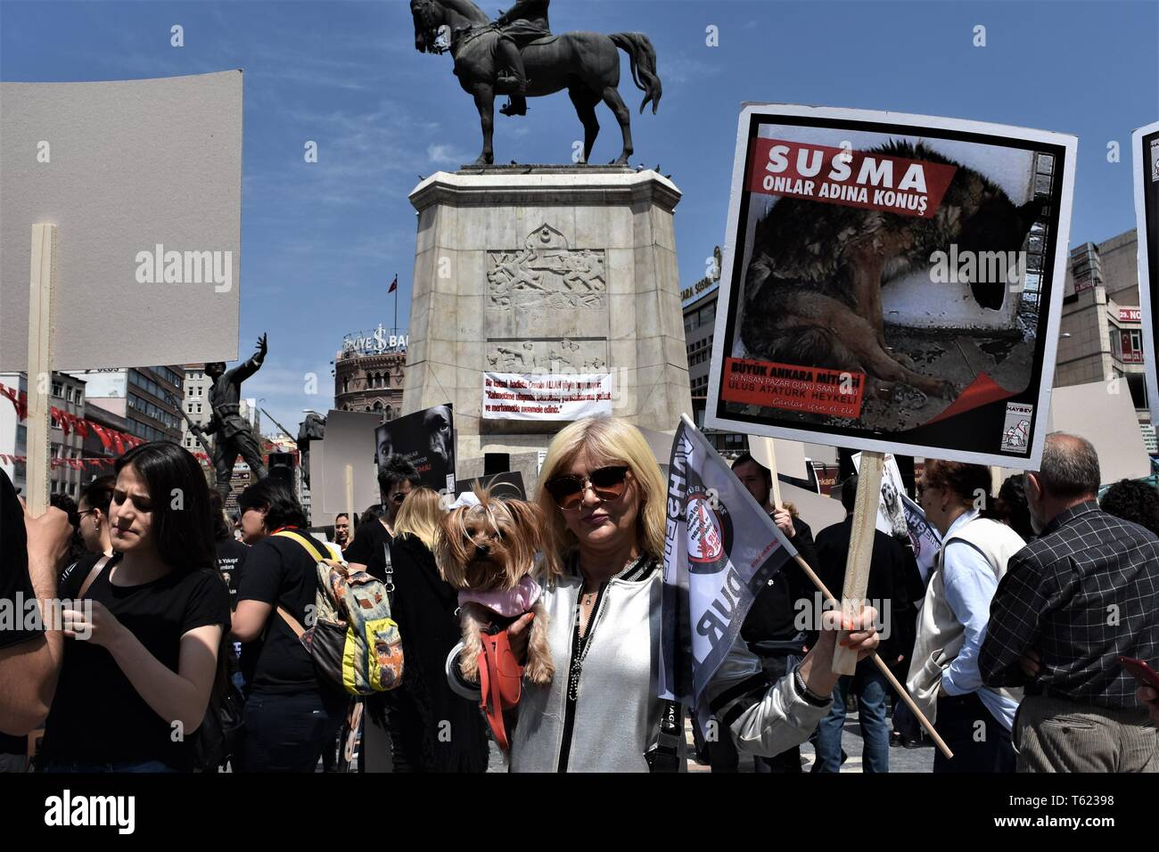 Ankara, Turkey. 28th Apr, 2019. A demonstrator poses with her dog during a protest for animal rights. Credit: Altan Gocher/ZUMA Wire/Alamy Live News - Stock Image