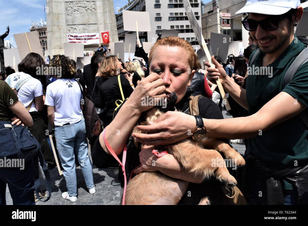 Ankara, Turkey. 28th Apr, 2019. A demonstrator kisses her dog during a protest for animal rights. Credit: Altan Gocher/ZUMA Wire/Alamy Live News - Stock Image