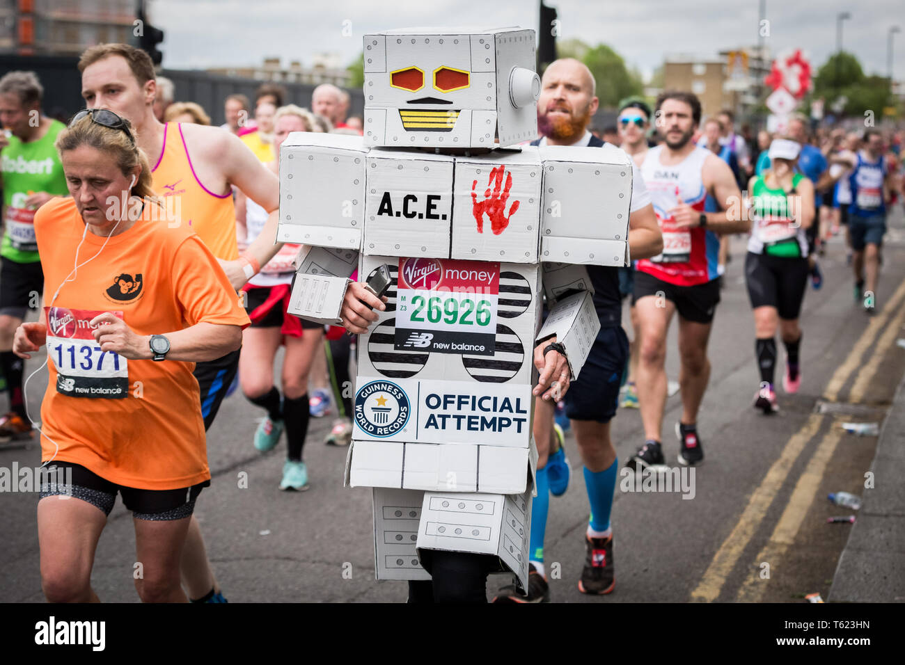 London, UK. 28th April, 2019. 39th London Marathon passes through Deptford's Evelyn Street in South East London, also the 8 mile mark of the 26.2 mile course where runners are greeted and cheered on by local residents. Credit: Guy Corbishley/Alamy Live News Stock Photo