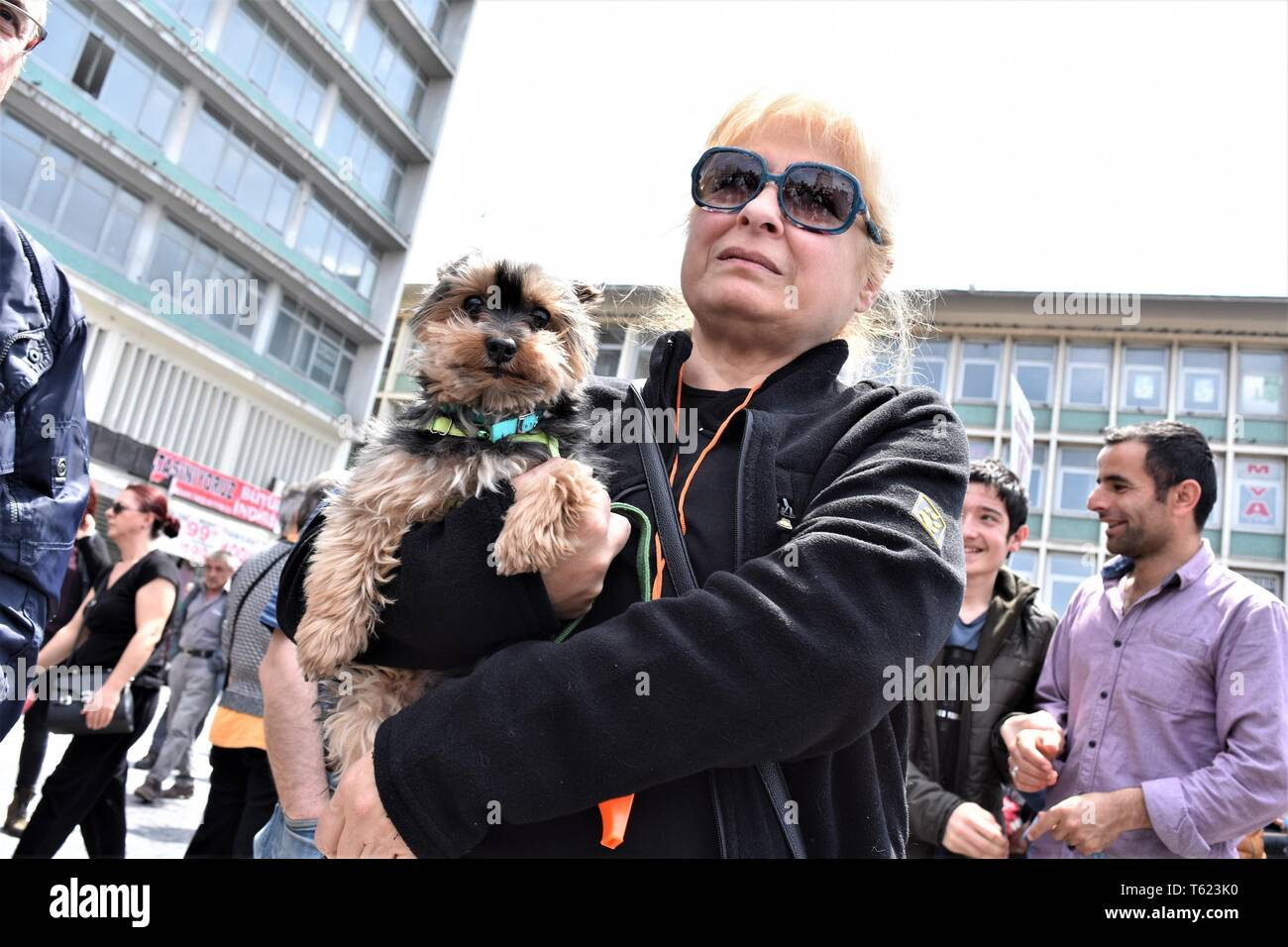 Ankara, Turkey. 28th Apr, 2019. A demonstrator holds her dog during a protest for animal rights. Credit: Altan Gocher/ZUMA Wire/Alamy Live News - Stock Image