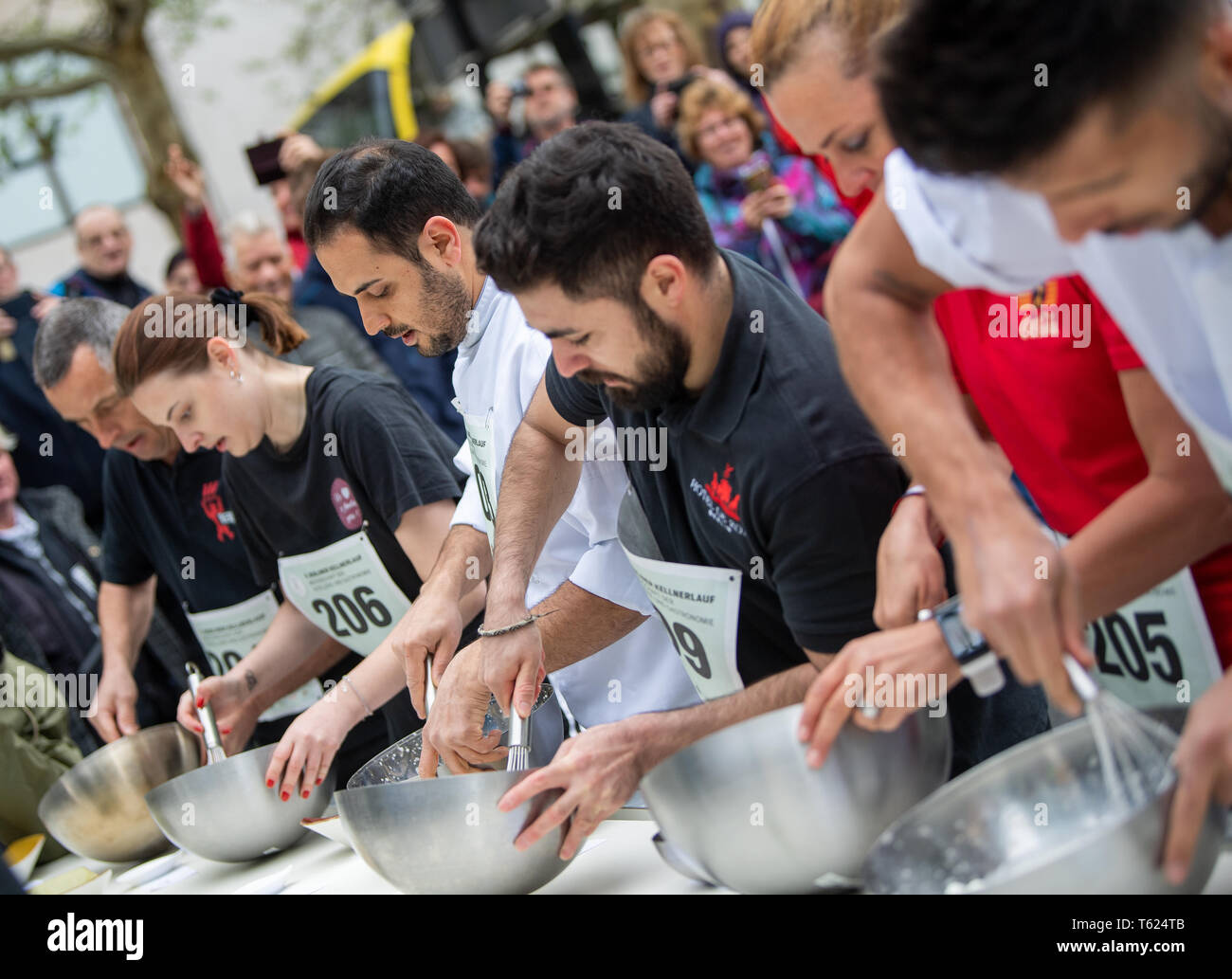 Berlin, Germany. 28th Apr, 2019. Cooks beat Eischnee for a dessert at the Berliner Kellnerlauf on Kurfürstendamm. Waiters, barkeepers, chefs and bellboys compete in the art of fast gastronomy. The 400 meter long running track is located on the one-sided closed Ku'damm. Credit: Monika Skolimowska/dpa-Zentralbild/dpa/Alamy Live News Stock Photo