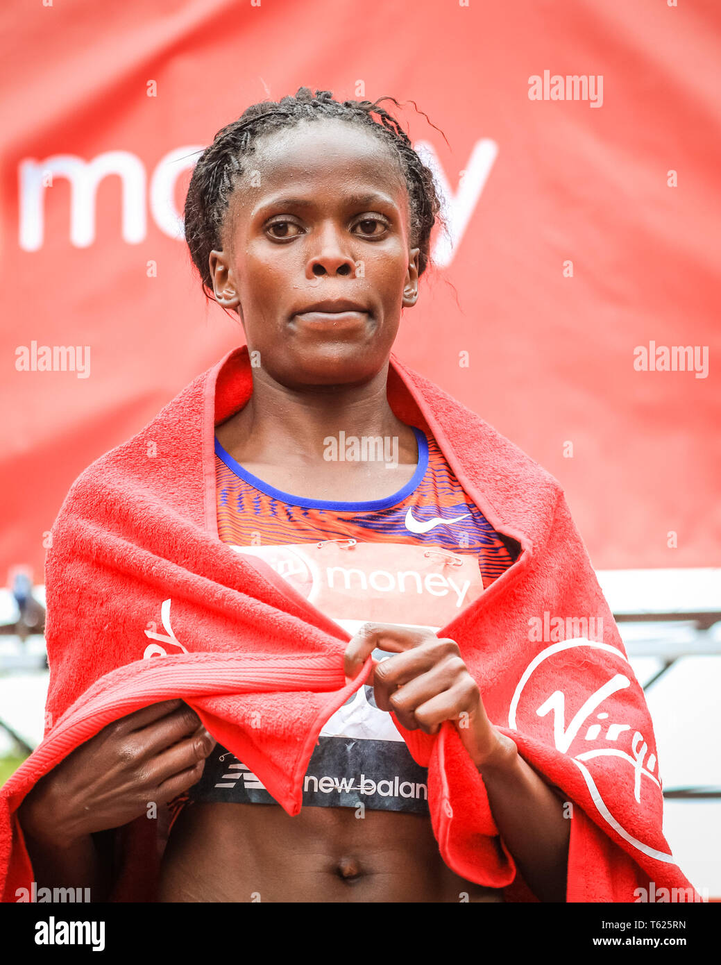 London, UK. 28th April 2019. Brigid Kosgei wins the women's race.The Mall with the finish line, Elite Men's and Women's races. The world's top runners once again assemble in for the London marathon, to contest the 39th race. Credit: Imageplotter/Alamy Live News Stock Photo