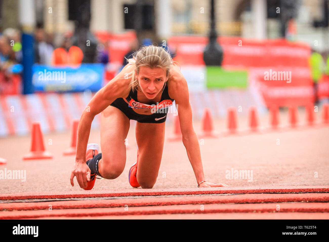 London, UK. 28th April 2019. Hayley  Carruthers (GBR) finishes the race in 2.33.59, but collapses just before the finish and crawls over the finish line. The Mall with the finish line, Elite Men's and Women's races. The world's top runners once again assemble in for the London marathon, to contest the 39th race. Credit: Imageplotter/Alamy Live News Stock Photo