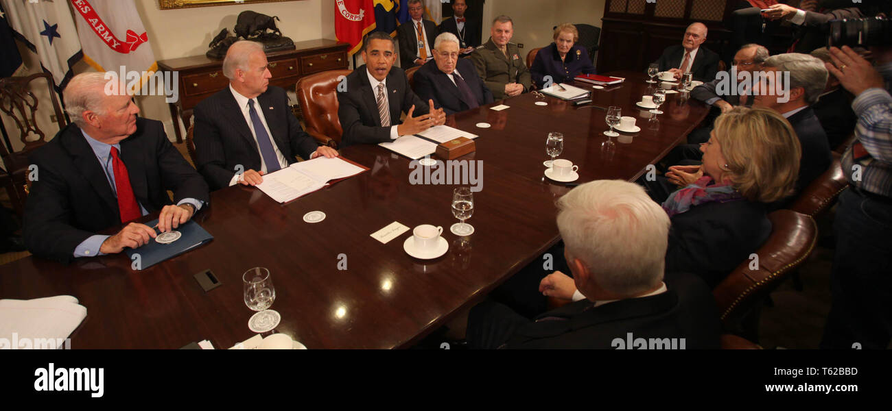 November 18, 2010 - Washington, District of Columbia, U.S. - United States President Barack Obama makes a statement during a meeting with present administration officials and former Secrtaries of State and Defense in the Roosevelt Room of the White House on Thursday, November 18, 2010. From left to right: James A. Baker III, former US Secretary of State; US Vice President Joseph Biden; President Obama; Henry Kissinger, former US Secretary of State; General James Cartwright, Vice Chairman Joint Chiefs of Staff; Madeleine Albright, former US Secretary of State; Brent Scowcroft, former Nation - Stock Image