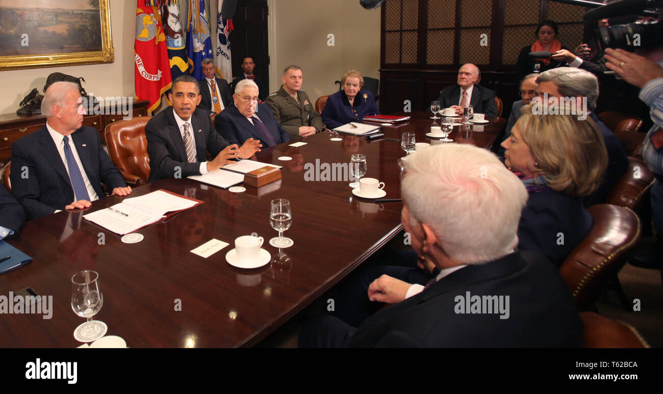November 18, 2010 - Washington, District of Columbia, U.S. - United States President Barack Obama makes a statement during a meeting with present administration officials and former Secrtaries of State and Defense in the Roosevelt Room of the White House on Thursday, November 18, 2010. From left to right: US Vice President Joseph Biden; President Obama; Henry Kissinger, former US Secretary of State; General James Cartwright, Vice Chairman Joint Chiefs of Staff; Madeleine Albright, former Secretary of State; Brent Scowcroft, former National Security Advisor; US Senator John Kerry (Democrat - Stock Image