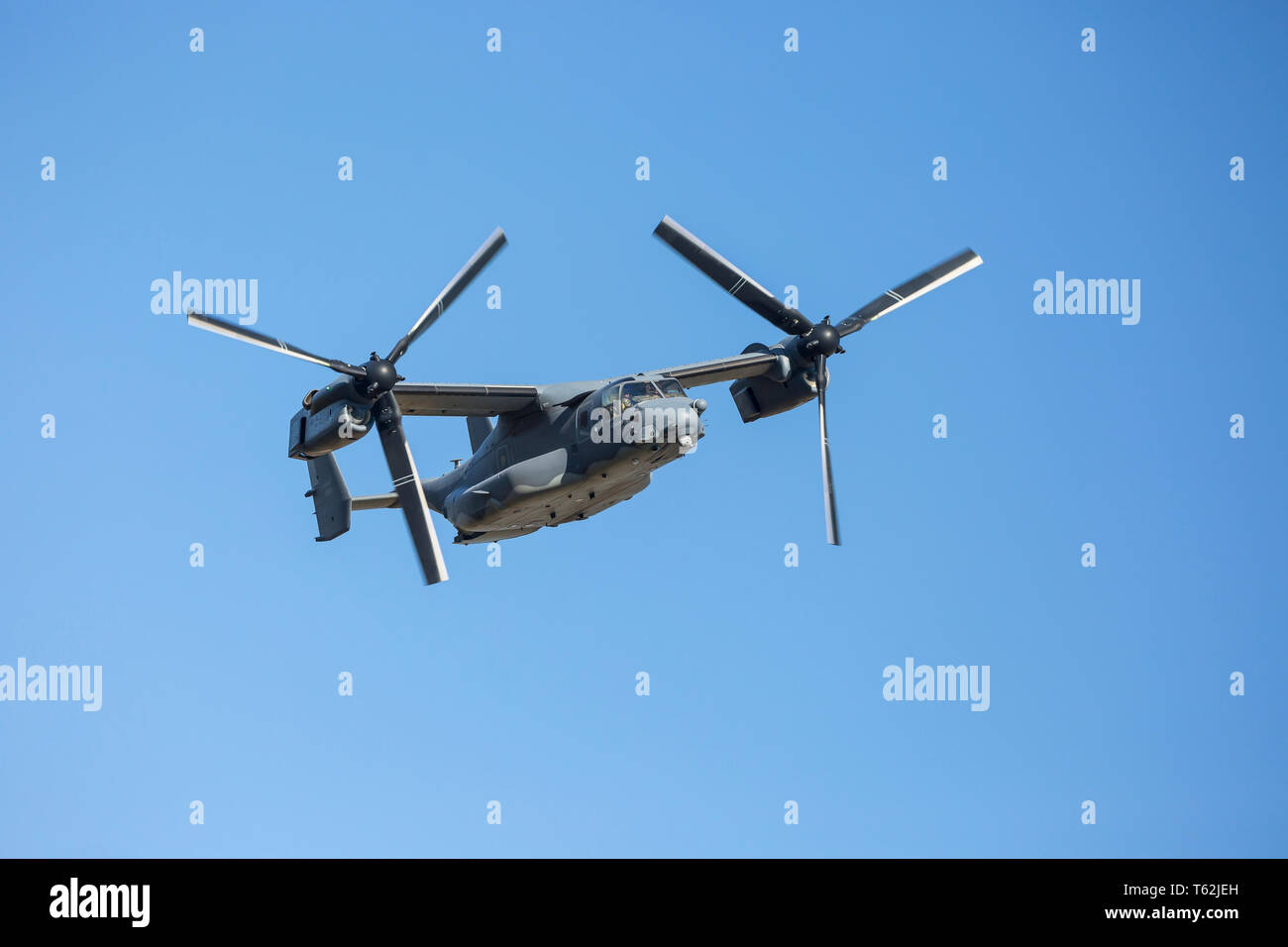 Close up of the American multi-mission Bell Boeing V-22 Osprey, a tilt-rotor military aircraft, in flight over the Mach Loop, Wales, UK. Stock Photo