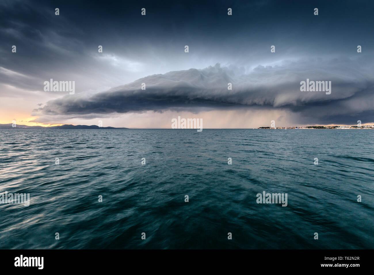 Storm on the sea. Striking cumulonimbus. Thunderstorm. Croatia. - Stock Image