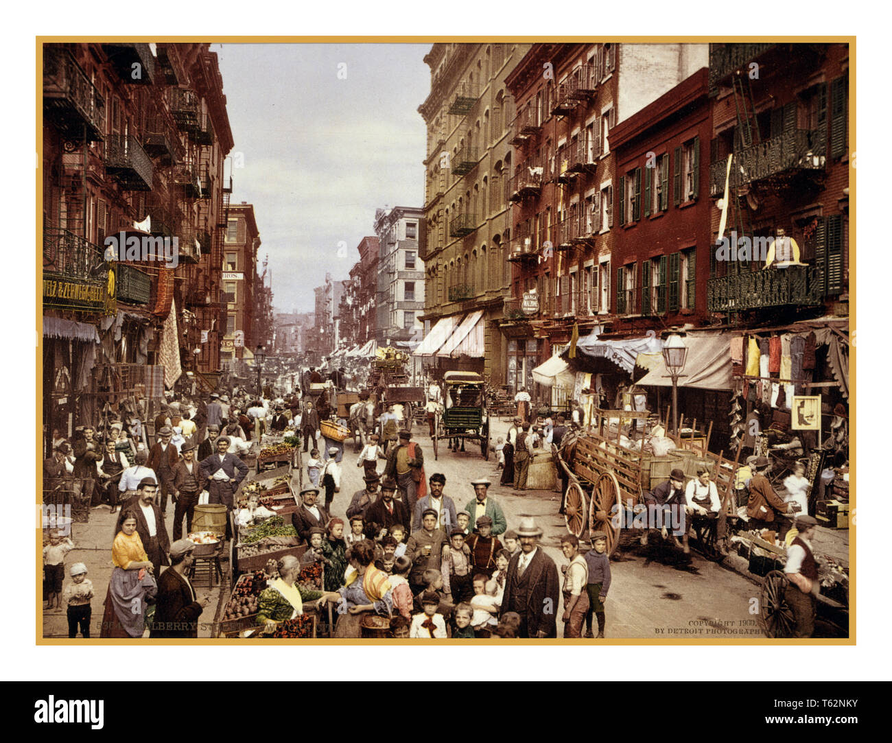 1890's Vintage Photochrom image of life on Mulberry Street Manhattan New York USA  A variety of life including all sorts of stores, groceries, fruit emporiums, tailors, shoemakers, wine merchants, importers, musical instrument makers, notaries, lawyers, doctors, apothecaries and undertakers … - Stock Image
