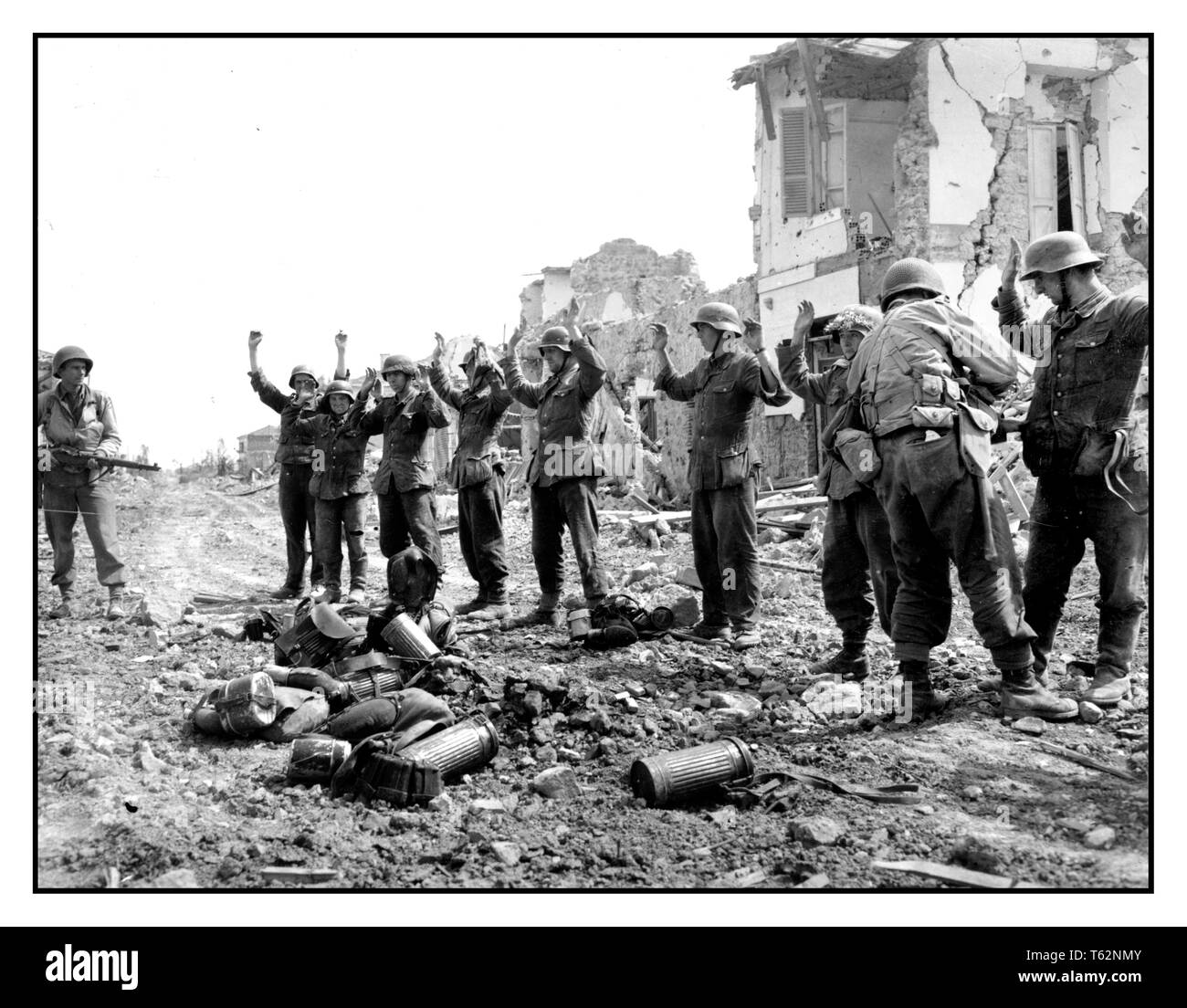 WW2 Propaganda image of German troops surrendering to US military at Anzio Italy.. German Troops surrender to American Forces The Battle of Anzio was a battle of the Italian Campaign of World War II that took place from January 22, 1944 to 5th June 1944 - Stock Image