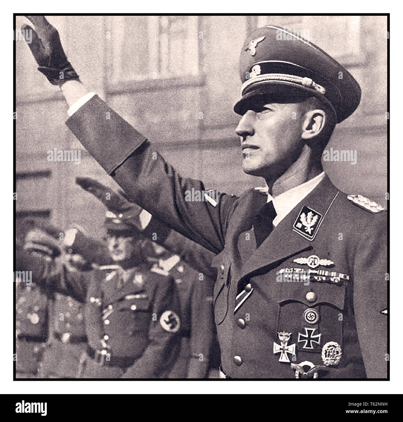 """WW2 REINHARD HEYDRICH 1940 Schutzstaffel (SS)-Obergruppenführer and General der Polizei Reinhard Heydrich, head of the Reichssicherheitshauptamt (Reich Main Security Office, RSHA), the combined security services of Nazi Germany, and acting Reichsprotektor of the Protectorate of Bohemia and Moravia Heydrich was one of the most powerful men in Nazi Germany and an important figure in the rise of Adolf Hitler; he was given overall charge of the """"Final Solution (Holocaust) to the Jewish question"""" in Europe He was rightly loathed by many and was assassinated by extremely brave Czech exile soldiers. Stock Photo"""