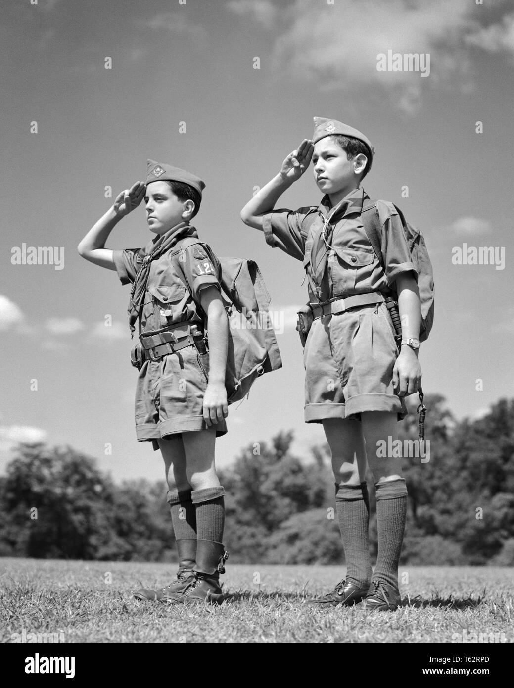 6b691d9ecbc 1950s TWO BOY SCOUTS WEARING SUMMER UNIFORMS STANDING AT ATTENTION EQUIPPED  WITH BACKPACKS THREE FINGER HAND SALUTING - b6033 HAR001 HARS HEALTHINESS  HOME ...