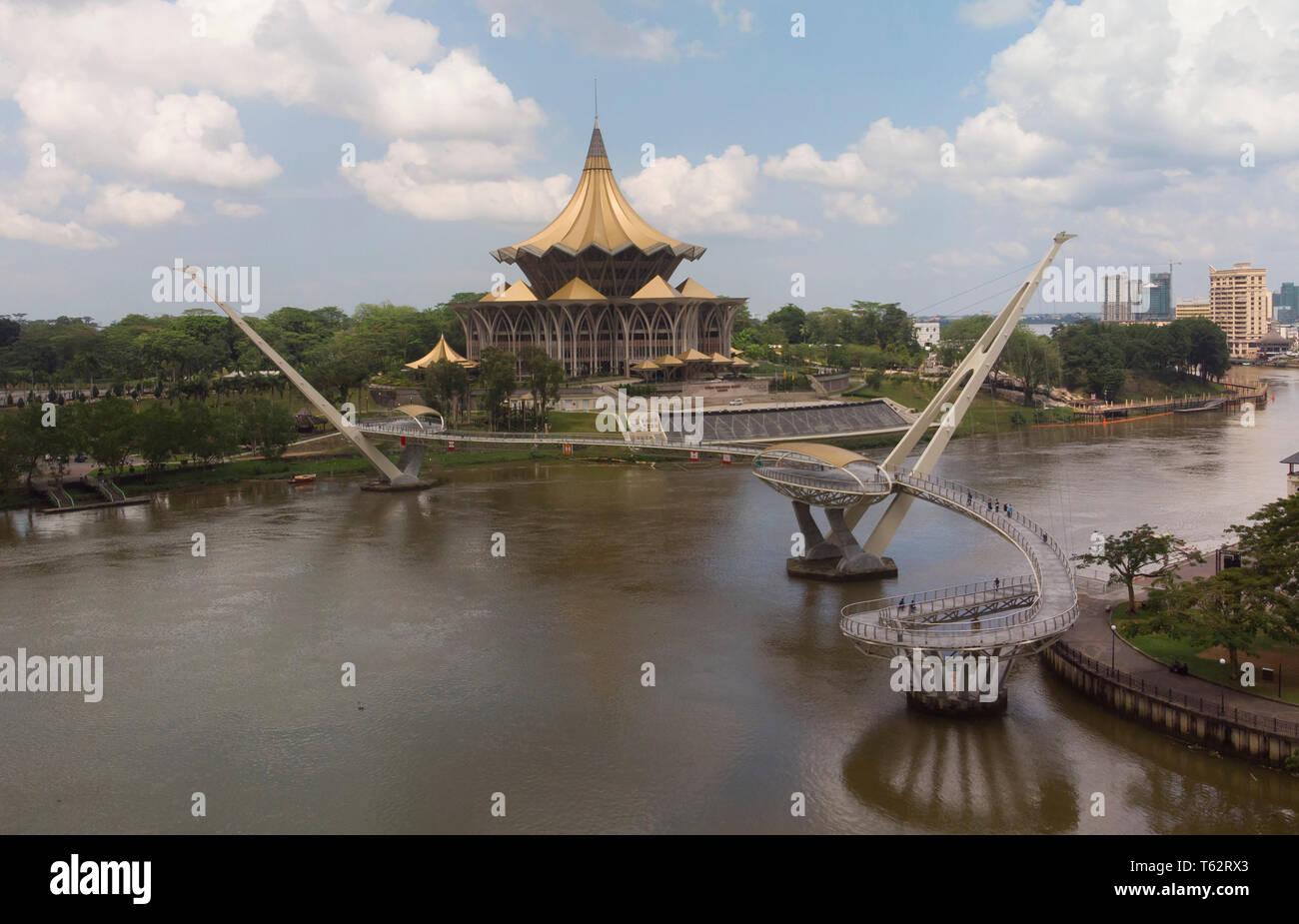 Drone photograph of Darul Hana bridge and Dewan Undangan Negri State Assembly building, Sarawak River, Kuching, Malaysia - Stock Image