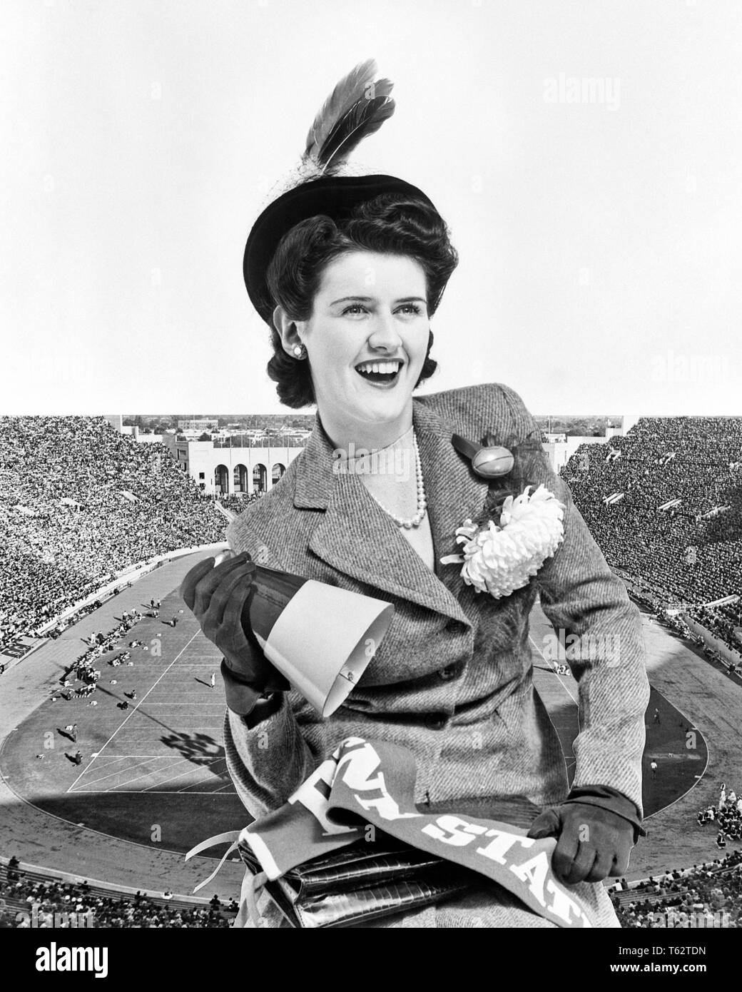 1940s SMILING BRUNETTE WOMAN COED ALUMNA WEARING HOMECOMING CORSAGE HOLDING MEGAPHONE COLLEGE PENNANT STADIUM BACKGROUND - f1689 HAR001 HARS PLEASED JOY LIFESTYLE CELEBRATION FEMALES STUDIO SHOT EVENT HEALTHINESS COPY SPACE HALF-LENGTH LADIES PERSONS B&W BRUNETTE HAPPINESS CHEERFUL STYLES COMPOSITE EXCITEMENT MUM RECREATION CHRYSANTHEMUM PRIDE PENNANT SMILES CORSAGE HOMECOMING JOYFUL STYLISH BOOSTER ALUMNI ATTENDING COED FASHIONS FOOTBALLS YOUNG ADULT WOMAN AMERICAN FOOTBALL BLACK AND WHITE CAUCASIAN ETHNICITY HAR001 OLD FASHIONED - Stock Image