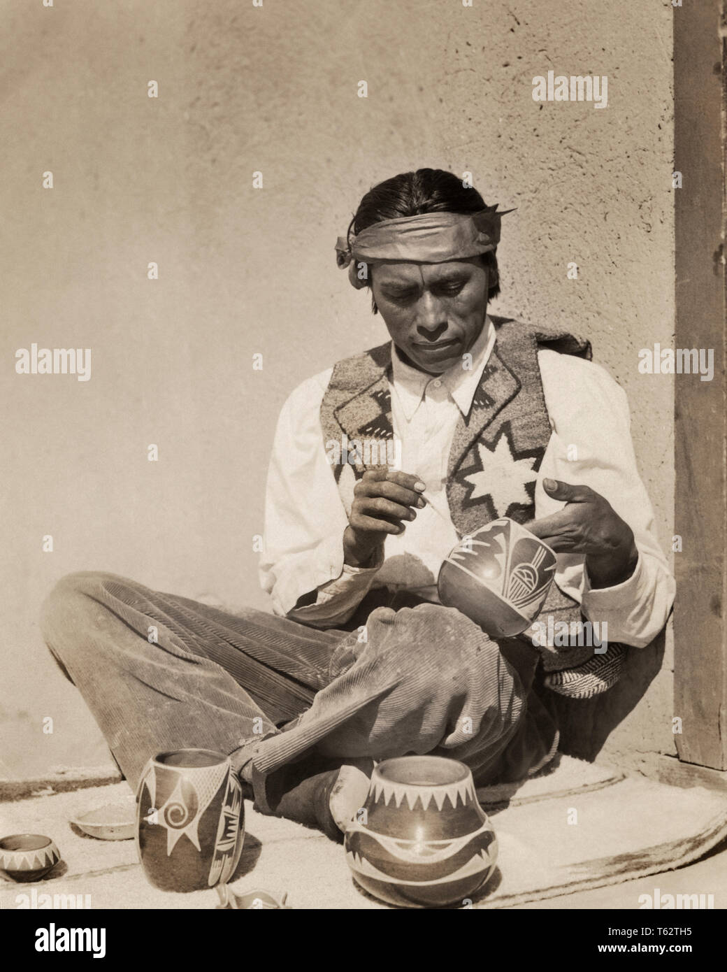 1930s Native American Man Painting Glazing Pottery San Ildefonso Pueblo New Mexico I1580 Har001 Hars B W North America High Angle Occupations Imagination Stylish Native American Pueblo Cooperation Creativity Mid Adult Mid Adult Man,Industrial Small Modern Office Design