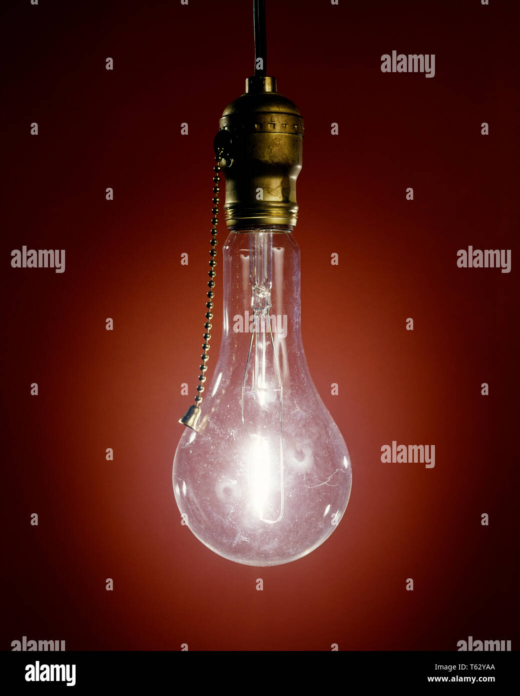 Antique Old Style Clear Glass Bare Light Bulb Hanging From Pull Chain Brass Socket Filament Is Glowing Incandescent Light Ks4924 Har001 Hars Old Fashioned Stock Photo Alamy