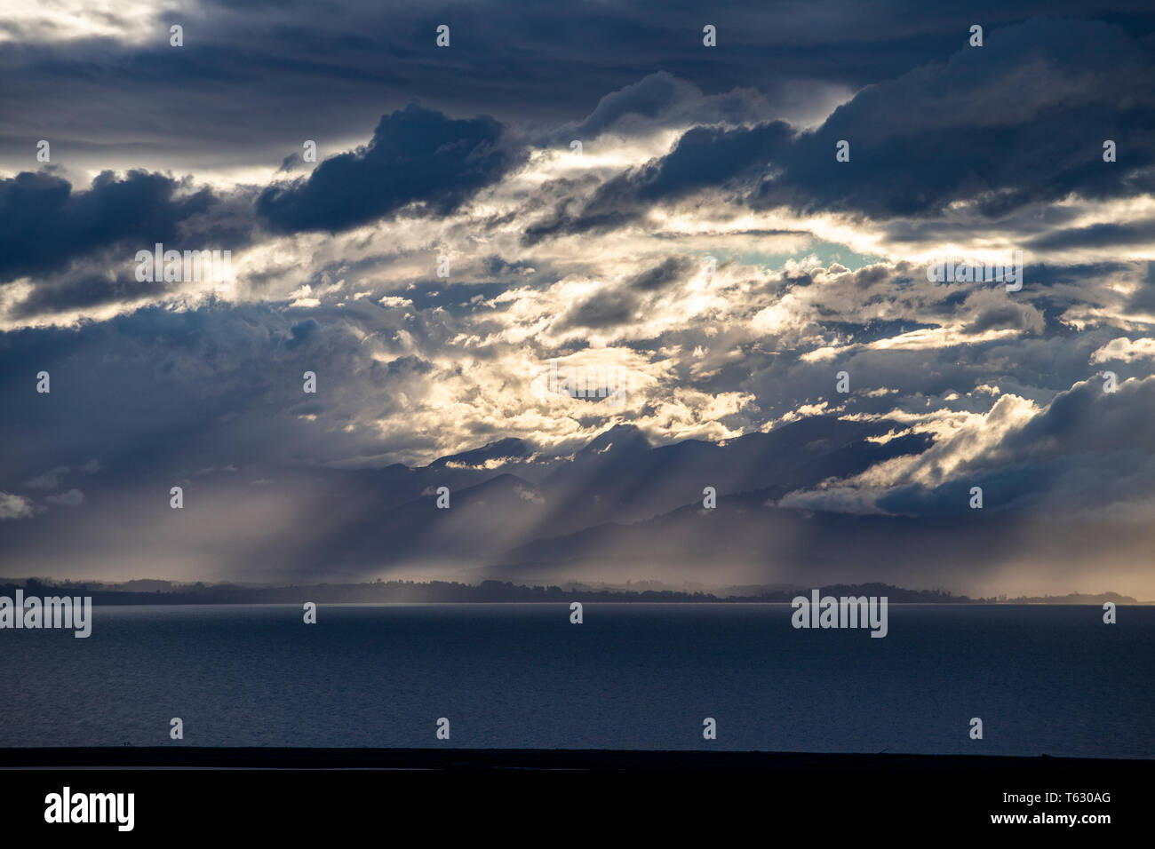 dramatic cloud formations over Tasman Bay, New Zealand Stock Photo