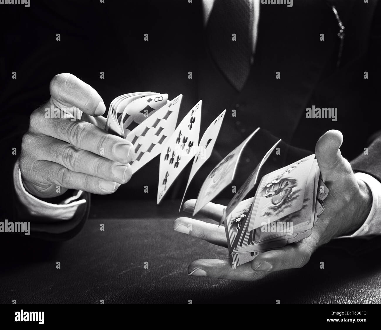 1960s HANDS OF MALE CARD FLOURISHING ARTIST SHOOTING DECK OF PLAYING CARDS FROM RIGHT TO LEFT HAND A PERFORMANCE OF CARDISTRY - s14574 HAR001 HARS OCCUPATIONS CONCEPT MOTION BLUR CONCEPTUAL CARD GAME SHUFFLING ARTISTRY SHUFFLE SYMBOLIC CONCEPTS PERFORMERS PLAYING CARDS BLACK AND WHITE CAUCASIAN ETHNICITY HANDS ONLY HAR001 OLD FASHIONED REPRESENTATION - Stock Image