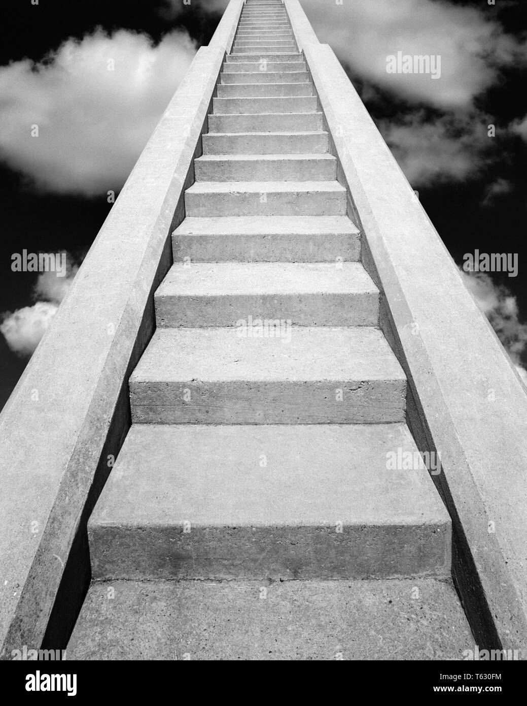 1960s VIEW AT BOTTOM OF SET OF CONCRETE STAIRS LOOKING UP TO THE TOP INTO THE CLOUDS THE HEAVENS THE SKY - s14723b HAR001 HARS CHOICE COMPOSITE EXTERIOR LOW ANGLE STAIR DIRECTION HEAVEN UP STAIRCASE STAIRWAY CONCEPT CONNECTION CONCEPTUAL STILL LIFE PARADISE STEEP STYLISH FAITHFUL SYMBOLIC CONCEPTS FAITH IDEAS LOOKING  UP REWARD BELIEF BLACK AND WHITE CONCRETE HAR001 OLD FASHIONED REPRESENTATION - Stock Image