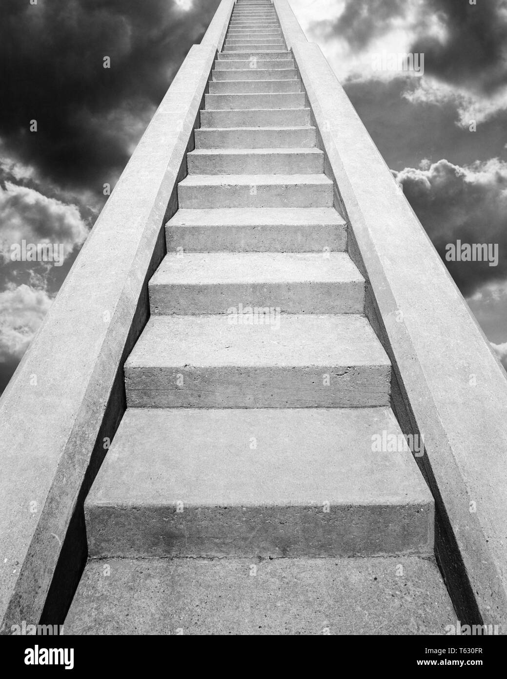 VIEW AT BOTTOM OF SET OF CONCRETE STAIRS  LOOKING UP TO THE TOP IN THE CLOUDS IN THE SKY IN THE HEAVENS - s14723e HAR001 HARS VICTORY HEAVENS CHOICE COMPOSITE EXTERIOR LOW ANGLE STAIR DIRECTION HEAVEN UP STAIRCASE STAIRWAY CONCEPT CONNECTION CONCEPTUAL STILL LIFE PARADISE STEEP STYLISH FAITHFUL SYMBOLIC CONCEPTS FAITH GROWTH IDEAS LOOKING  UP REWARD BELIEF BLACK AND WHITE CONCRETE HAR001 OLD FASHIONED REPRESENTATION - Stock Image