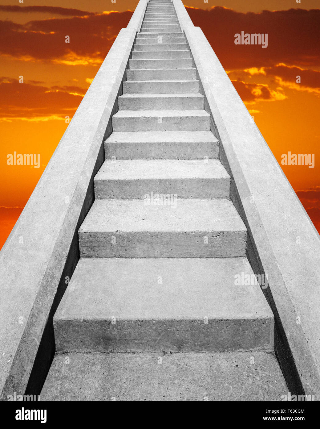 VIEW AT BOTTOM OF SET OF CONCRETE STAIRS  LOOKING UP INTO THE SKY THE HEAVENS SUNSET - s14723g HAR001 HARS HEAVENS CHOICE COMPOSITE EXTERIOR LOW ANGLE STAIR DIRECTION HEAVEN UP STAIRCASE STAIRWAY CONCEPT CONNECTION CONCEPTUAL STILL LIFE PARADISE STEEP FAITHFUL SYMBOLIC CONCEPTS FAITH IDEAS LOOKING  UP REWARD BELIEF CONCRETE HAR001 OLD FASHIONED REPRESENTATION - Stock Image