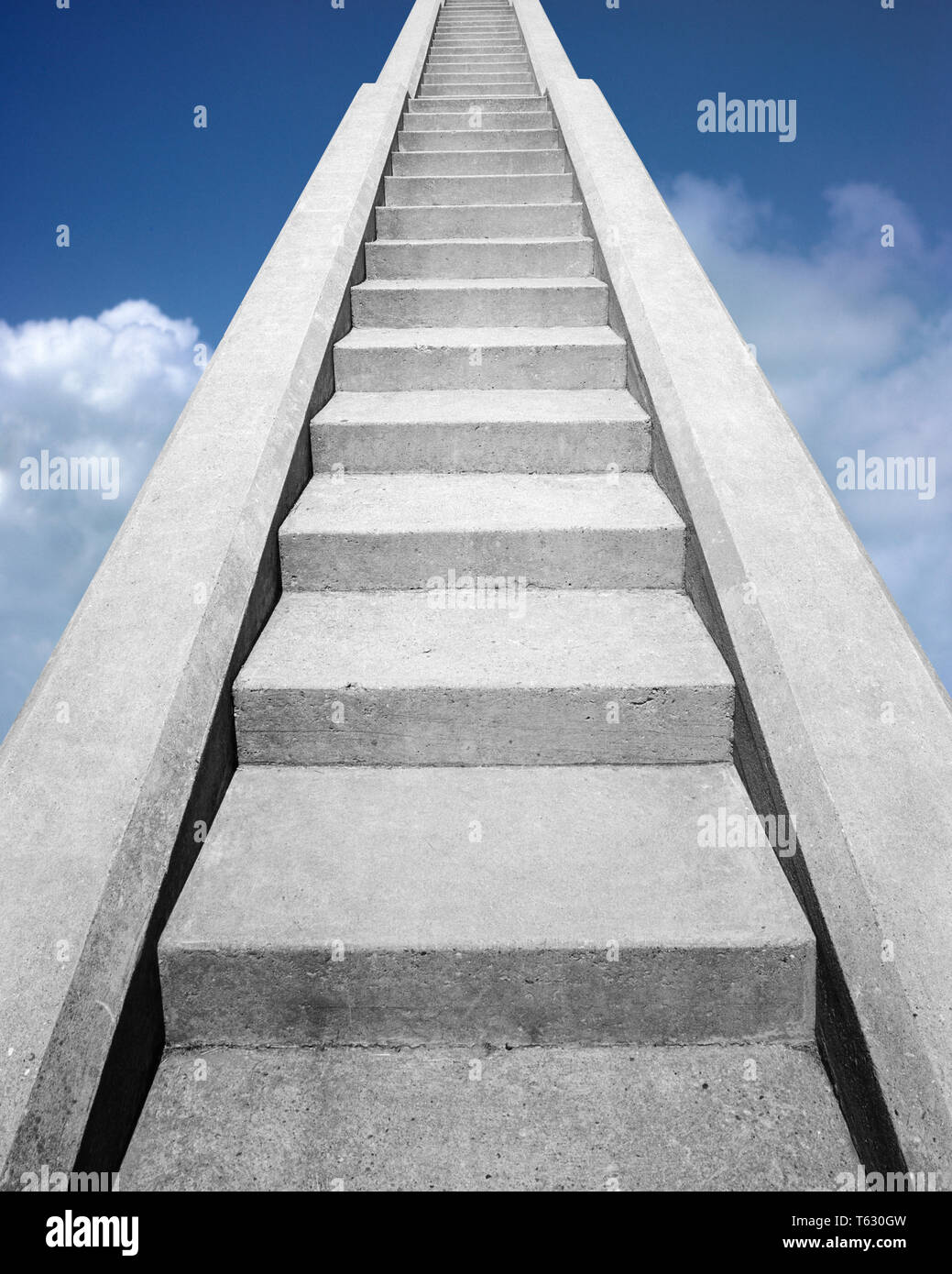 VIEW AT BOTTOM OF SET OF CONCRETE STAIRS  LOOKING UP TO THE TOP INTO A BLUE SKY - s14723f HAR001 HARS VICTORY HEAVENS CHOICE COMPOSITE EXTERIOR LOW ANGLE STAIR DIRECTION HEAVEN UP STAIRCASE STAIRWAY CONCEPT CONNECTION CONCEPTUAL STILL LIFE PARADISE STEEP STYLISH FAITHFUL SYMBOLIC CONCEPTS FAITH GROWTH IDEAS LOOKING UP REWARD BELIEF CONCRETE HAR001 OLD FASHIONED REPRESENTATION - Stock Image