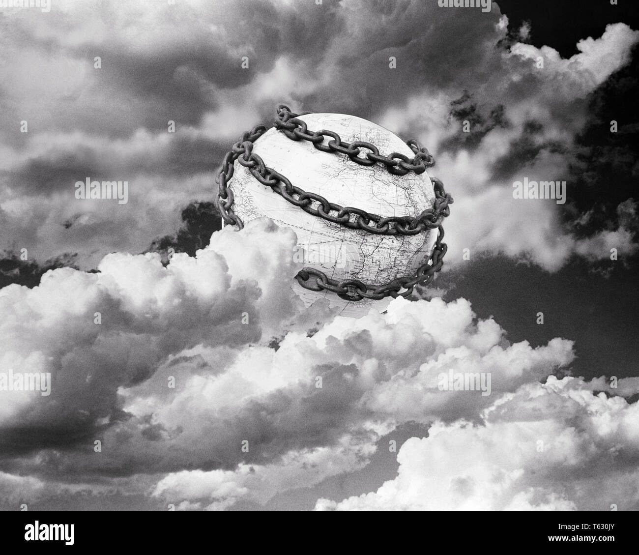 1930s SYMBOLIC ILLUSTRATION OF EARTH  WRAPPED IN CHAINS SURROUNDED BY CLOUDS - s4287 HAR001 HARS REPRESENTATION - Stock Image
