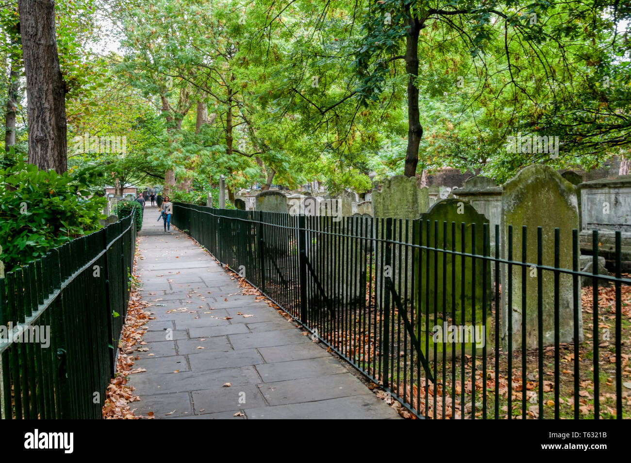 The former burial ground of Bunhill Fields in Islington, North London, is listed Grade I on the Register of Historic Parks and Gardens. - Stock Image