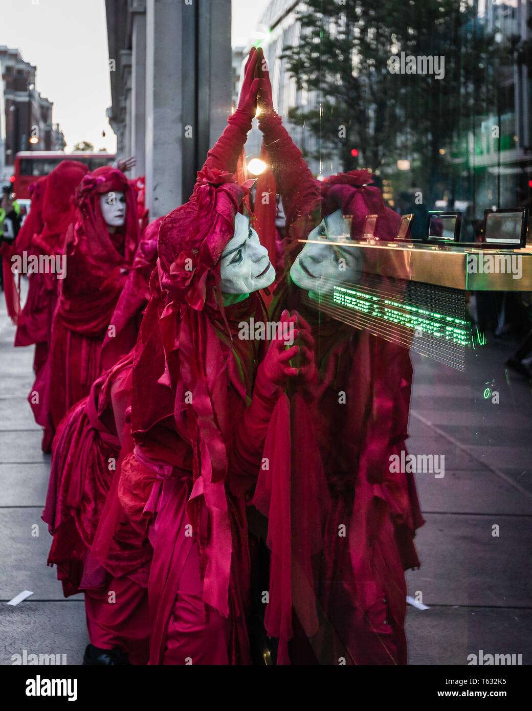 Extinction Rebellion environmental activist group, The Red Brigade seen protesting at Selfridges on Oxford Street on April 25, 2019 in London - Stock Image