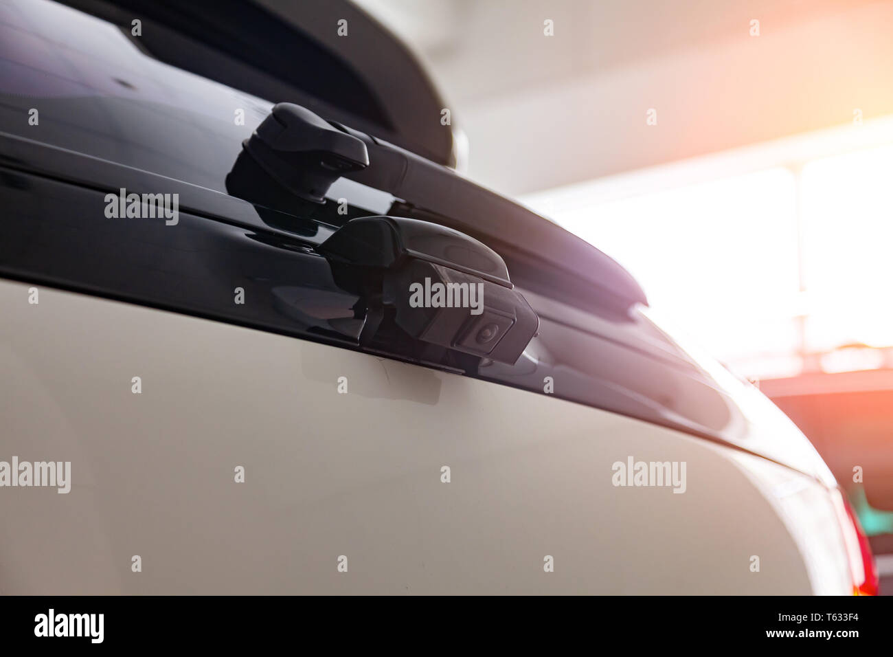 Close-up Interior view with rear view camera on the trunk of luxury very expensive new white car suv stands after cleaning in the vehicle repair works - Stock Image