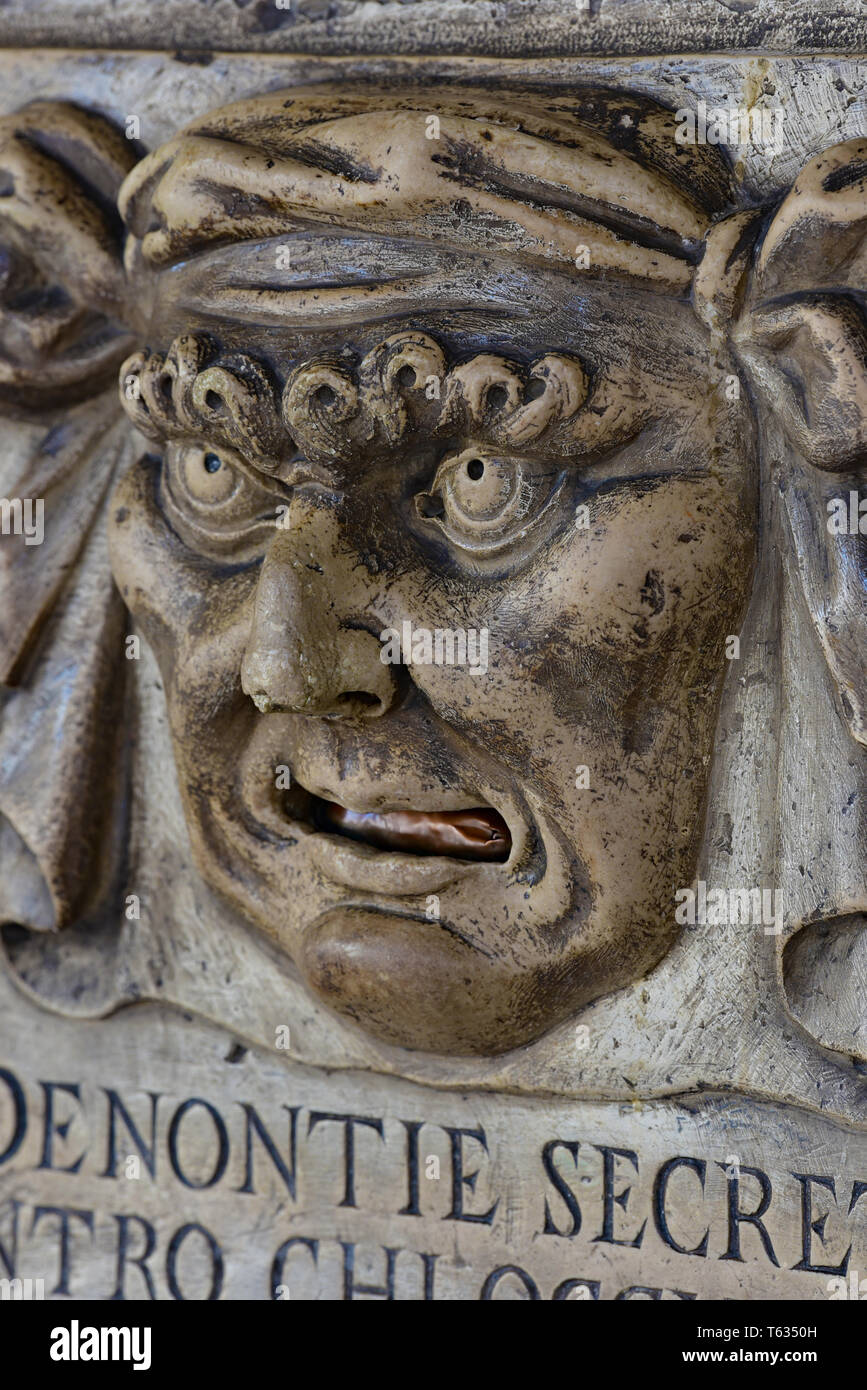 The 'Boca di Leone' (Lion's Mouth), a secret anonymous letterbox used by Venetians for denouncing tax evaders, Doge's Palace, Venice, Italy, Europe. Stock Photo