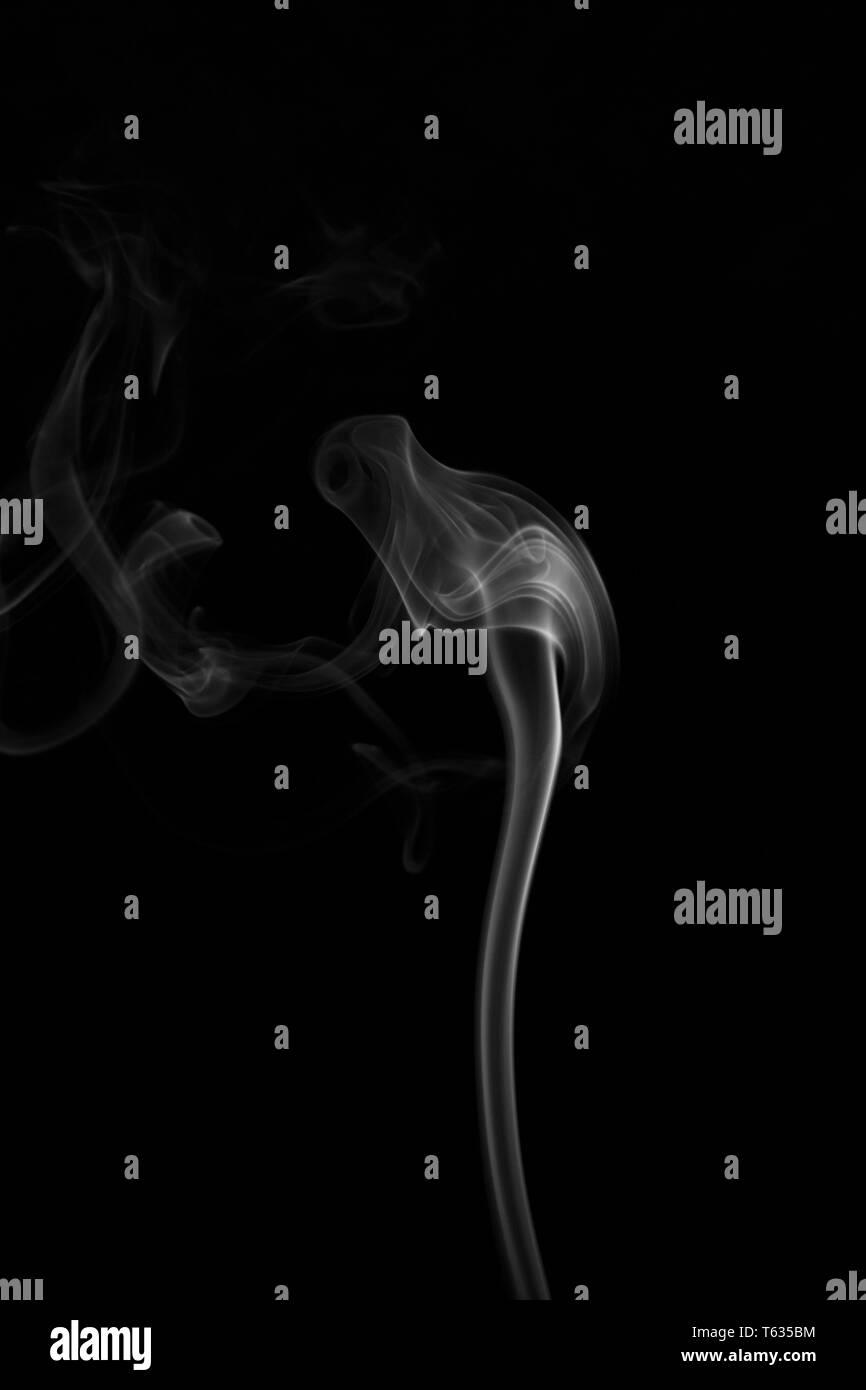 White Smoke on a Black Background - Stock Image
