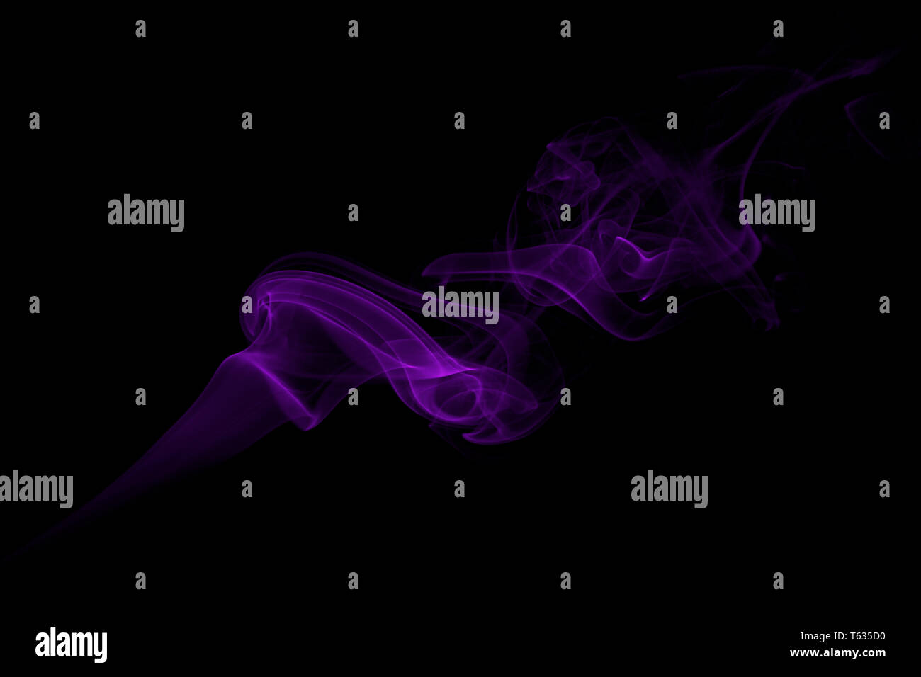Purple Smoke on a Black Background - Stock Image