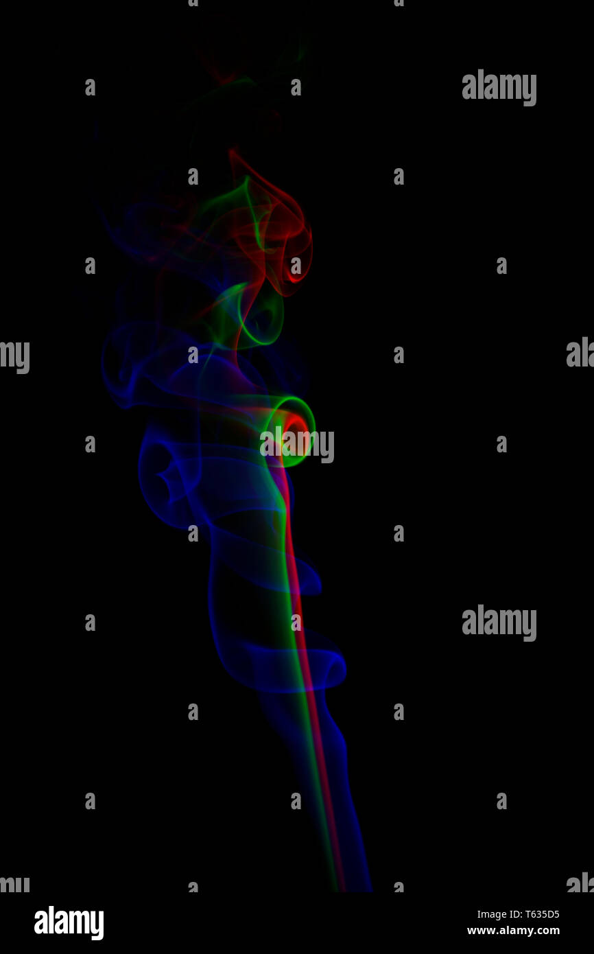 Multicolored Smoke Isolated on Black - Stock Image
