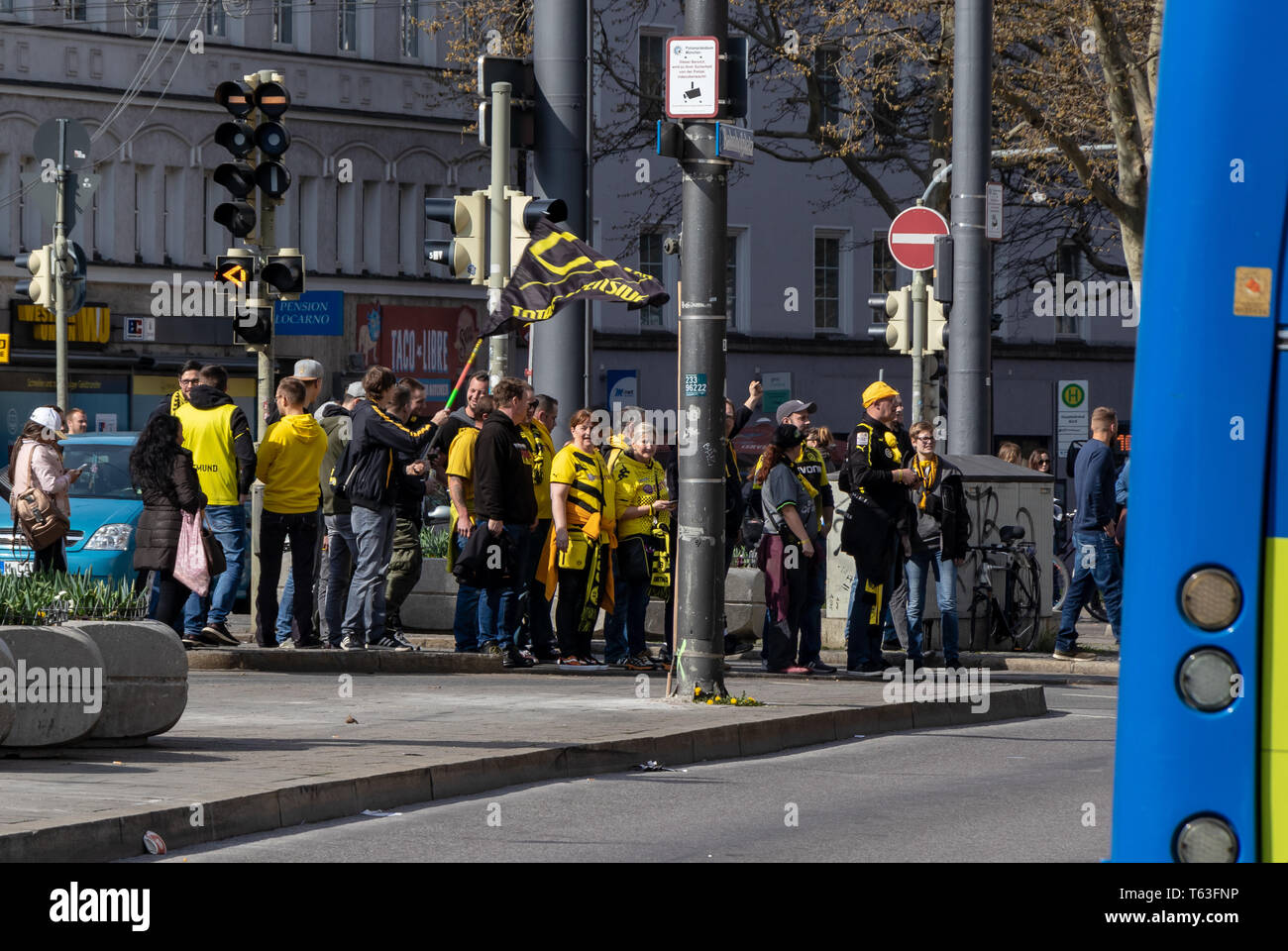 CENTRAL STATIONS, MUNICH, APRIL 6, 2019: bvb fans on the way to the soccer game fc bayern munich vs bvb - Stock Image