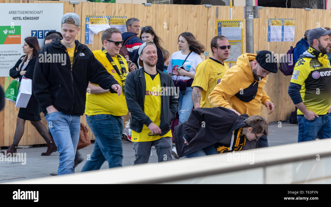 STACHUS, MUENCHEN, APRIL 6, 2019: bvb fans on the way to the soccer game fc bayern munich vs bvb - Stock Image